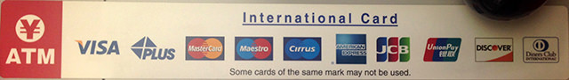 Sign placed on ATMs showing acceptable credit cards