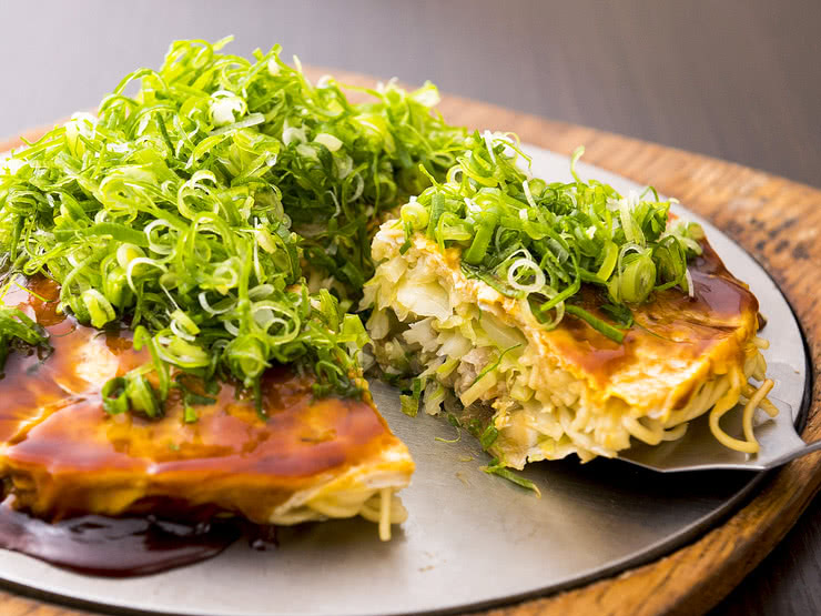 Okonomiyaki is Osaka's Savory and Social Japanese Pancake