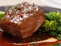 Cuoco di Mare_Beef cheek meat cooked in red wine sauce with warm vegetables.