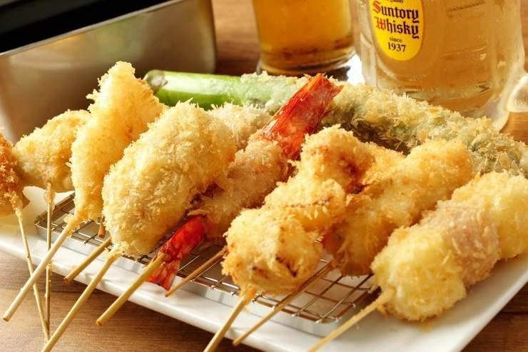 Enjoy kushiage - hot crispy fried seasonal fast food from western Japan